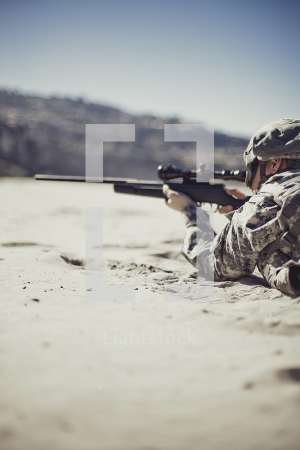 Soldier pointing rifle