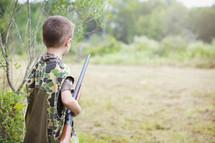 boy with a shotgun