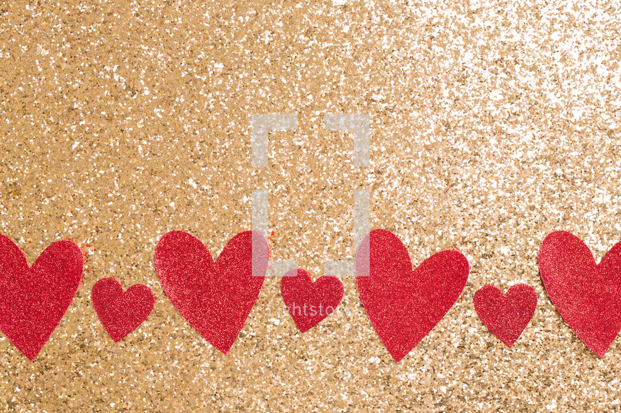 red hearts on gold