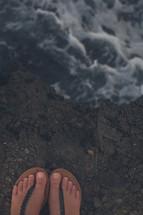 flip flops standing on rocks