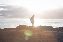 a man walking on a shore