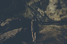 woman walking in a cave