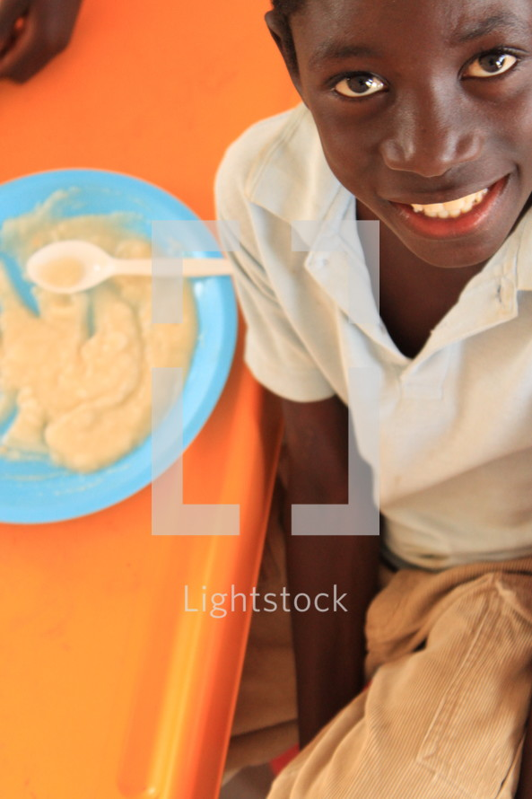 boy child in front of a bowl of mush
