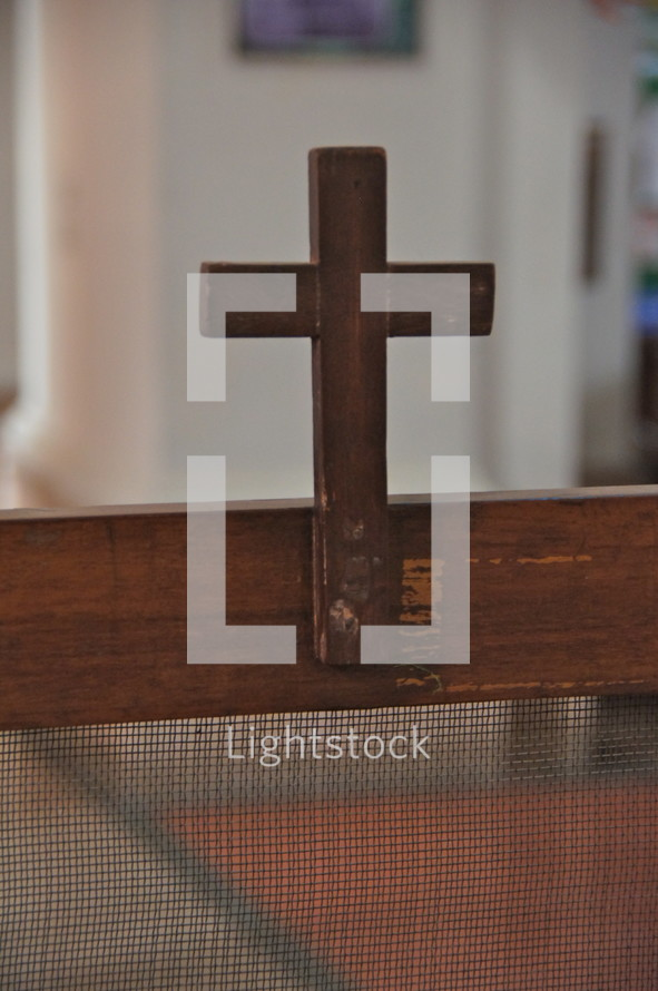 Wooden cross in an old church building