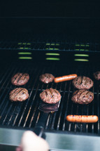 hamburgers and hotdogs on a grill