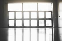 sunlight shining through the windows onto a floor