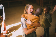 missionary hugging a boy child