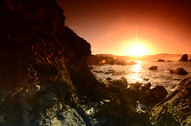 a rocky shore at sunset