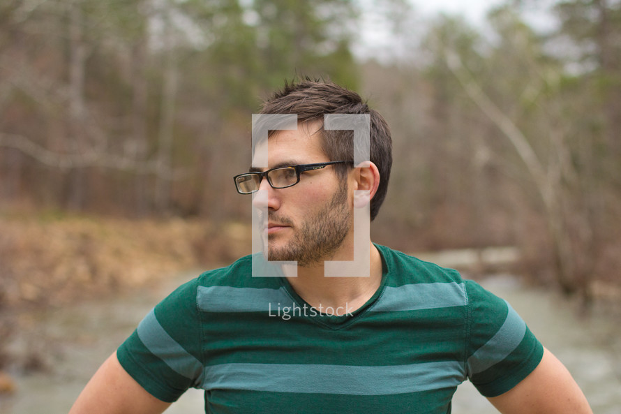 profile of a man wearing glasses