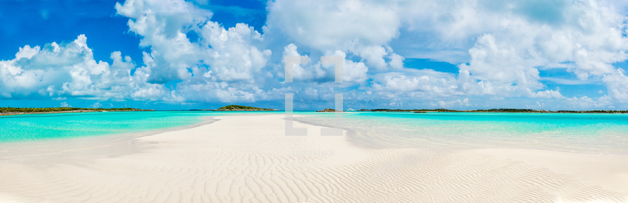 white sand beach and turquoise shoreline