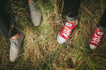 shoes and feet in the grass