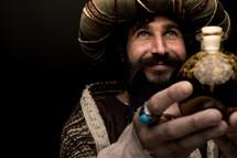 a wiseman holding a gift of myrrh