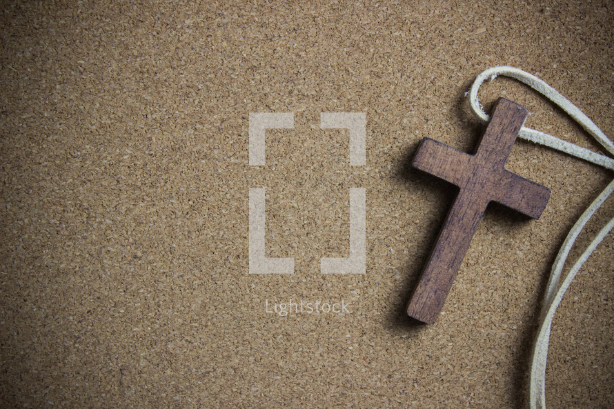 wooden cross and a leather cord