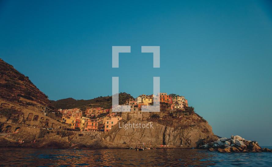 European hilltop village by the ocean.