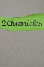 torn open kraft paper over green paper with the name of the 2 book of Chronicles