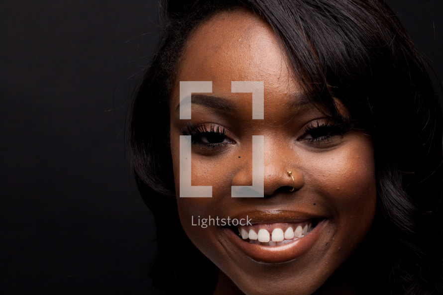 face of a smiling young African American woman