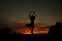 silhouette of a dancer at sunset