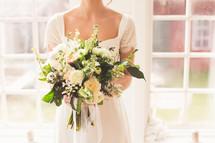 a bride holding a bridal bouquet