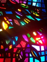 Stained Glass Light prism reflecting the light and glory of Gods presence with rays of sunlight lighting the room.