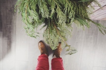 feet and Christmas greenery