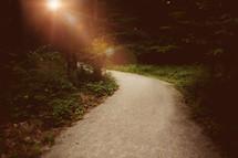 sunburst over a path