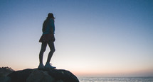 woman standing on a rock
