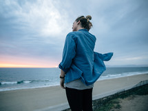 a woman looking out at the ocean