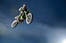 A man on a motorcycle flying through the air.