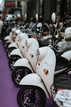row of white scooters