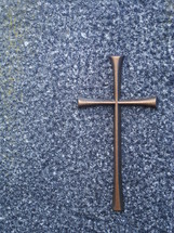 bronze cross on a stone, 