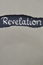 Revelation - torn open kraft paper over dark red paper with the name of the book: revelation