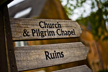 church and pilgrim chapel ruins arrows sign