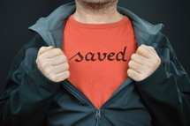a man with the word saved on his t-shirt