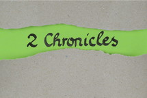Title 2 Chronicles - torn open kraft paper over green paper with the name of the second book of Chronicles