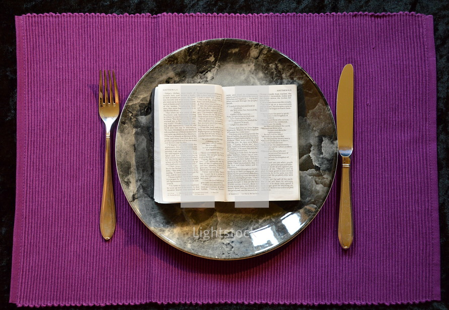 bible opened up at Matthew 4:4  on a plate,