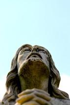 Praying Jesus statue