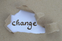 ripped open paper with the word CHANGE