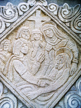 A carved stone and sand relief of Jesus being taken off the cross and surrounded by his followers, disciples and his mother, Mary. When we read about the crucifixion and death of Jesus, it is a piece of history that has changed the world over and hard to imagine being there so we rely on artists, craftsman and sculptures to retell the story to bring scripture to life so that seeing is believing. The artist does their part to bring us back in time to be there in person through art. As long as hearts are changed by the gospel, then the creative work has accomplished its goal which is to bring scripture alive to us today who can witness the emotion, the drama and the reality of the gospel and feel a part of what it must have been like to witness that moment when Jesus was taken off the cross and buried by His disciples, family, friends and followers. We know the story has a happy ending and that is the beautiful thing. To be able to bring scripture to life to those who think the bible is an old and irrelevant book is a challenging task but one that is worth taking up and even be persecuted for. if we can lead one soul to Christ through the spreading of Gods world through art and imagery, then we have allowed God to work through us to bring others to Him. And that is the beauty of knowing Jesus.