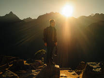 man standing under rays of sunlight outdoors