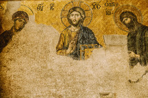 Faded ancient paintings on a Cathedral wall in Turkey.
