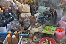 Tribal witchcraft potions and objects  Note Rhino horn at centre.