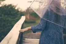 a woman walking under an umbrella