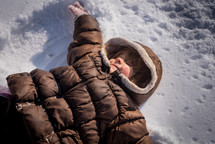 a child making snow angels