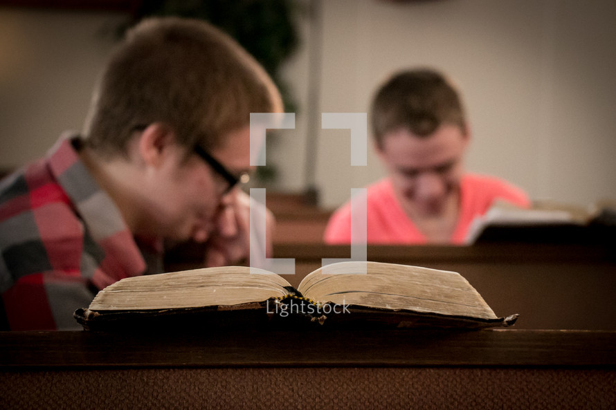 open Bibles and conversation in church pews