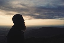 silhouette of a man with a beard