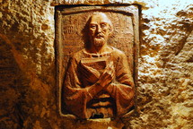 A terra cotta (oven-fired clay) plaque showing St. Jerome, the translator of the Latin translation of the Bible (the Vulgate) and the patron saint of Biblical scholars and translators. This plaque is found in the crypt of St. Jerome, under the Church of the Nativity in Bethlehem, where Jerome spent much of his life.