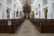 a woman praying alone in a church in Church in Altoetting Bavaria Germany
