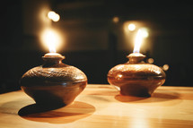 oil lamps on an old wooden table in church