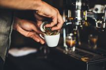 barista making an espresso shot