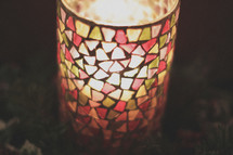 A stain glass candle light centerpiece